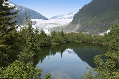 Mendenhall Glacier and Lake Near Juneau Alaska. Panoramic view of the Mendenhall Glacier which is near Juneau, Alaska. This is a popular tourist stop for those royalty free stock photo