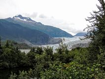 Mendenhall Glacier and Lake Near Juneau Forest taken from Trail to Glacier royalty free stock photo