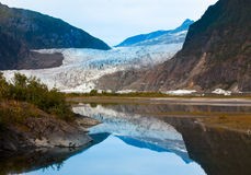 Mendenhall Glacier Reflection. The Mendenhall Glacier reflected in an adjacent river royalty free stock image