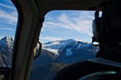 Mendenhall glacier seen through helicopter cockpit. Mendenhall Glacier is a glacier about 13.6 miles long located in Mendenhall Valley, about 12 miles from Stock Photos