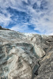 Mendenhall Glacier on sunny cloudy sky Stock Photos