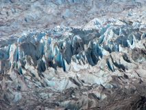 Mendenhall Glacier Surface Formations. Mendenhall Glacier surface characterized by sharp peaks and crevasses. Glacier's face and surface are a delicate blue Stock Photo