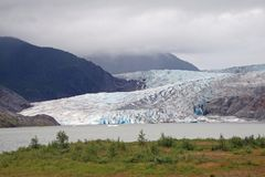 Mendenhall Glacier and Valley, Alaska. Mendenhall Glacier and Valley, Alaska, photographed from the Visitor Center on an overcast summer day royalty free stock photos