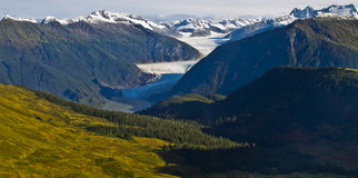 Mendenhall glacier valley. Mendenhall Glacier is a glacier about 13.6 miles long located in Mendenhall Valley, about 12 miles from downtown Juneau in the Stock Photography