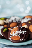 Mendiant traditional French chocolate candy for Christmas holiday. Homemade dessert with nuts and dried fruits. Xmas food. Mendiant traditional chocolate candy royalty free stock image