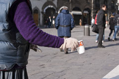 Mendicancy. Mendicant asking for money in the middle of the street Royalty Free Stock Images
