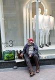 Mendigo com cão Imagens de Stock