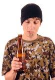 Mendigo con la cerveza Imagenes de archivo