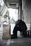 Mendigo en la calle Imagenes de archivo