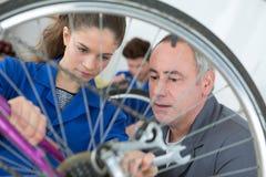 Mending bicycle tire rim. Mending the bicycle tire rim Stock Image