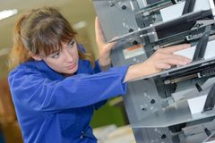 Mending a complex machine. Work Stock Photography