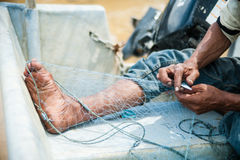 Mending fishing net Royalty Free Stock Photo