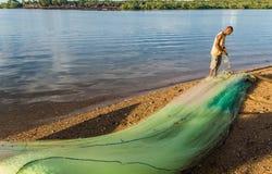 Mending fishing net Stock Images