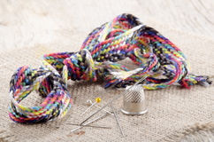 Mending kit and needle on jute Stock Photo