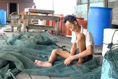 Mending nets. Weaving nets.Is the job of the fishermen Stock Photo