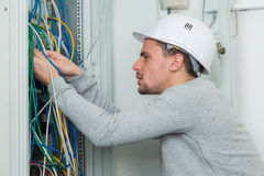 Mending tangles in cables Royalty Free Stock Photo
