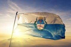 Mendoza province of Argentina flag textile cloth fabric waving on the top sunrise mist fog. Beautiful royalty free stock image