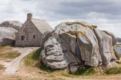 Stone buliding Meneham house in Brittany, France. Meneham in french Brittany house surrounded by the rocks Stock Photos