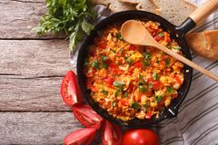 Menemen in a pan and ingredients closeup. horizontal top view Royalty Free Stock Photo