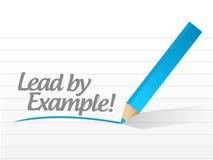 Menez par l'exemple écrit sur un morceau de papier blanc Photos stock