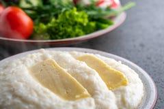 Mengrelian corn mamalica ghomi with cheese. Georgian food stock photo