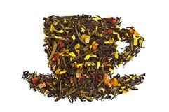 Mengsel van droge thee in een kop royalty-vrije stock afbeelding