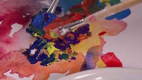 Mengsel van verscheidene kleurengouache stock footage