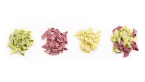 Mengsel van verschillende kleurrijke geïsoleerde garganelli Royalty-vrije Stock Foto's