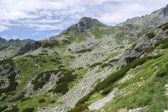 Mengusovska dolina, important hiking trail to hight mount Rysy, High Tatra mountains, Slovakia, amazing view with green hills. And blue sky royalty free stock photography
