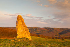 Menhir on the hill at sunset in Morinka village Stock Images