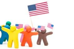Menigtegroep kleurrijke plasticinemensen met Stock Foto