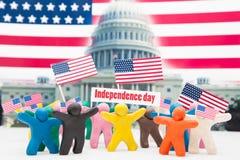 Menigtegroep kleurrijke plasticinemensen met Stock Fotografie