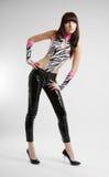 Menina à moda que dobra-se à esquerda Imagem de Stock Royalty Free