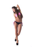 Menina à moda que levanta no biquini, isolado no branco Foto de Stock Royalty Free