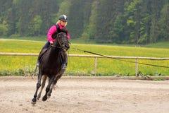 A menina é equitação rápida Foto de Stock Royalty Free