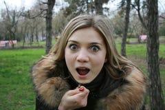 A menina é espantada muito Foto de Stock