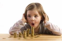 A menina é espantada sobre o dinheiro Fotografia de Stock Royalty Free
