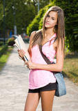 Menina adolescente amigável bonita do estudante. Imagens de Stock Royalty Free