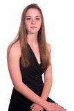 Menina adolescente atento assentado Fotografia de Stock Royalty Free