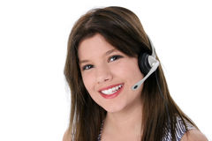 Menina adolescente bonita com os auriculares sobre o branco Imagens de Stock Royalty Free