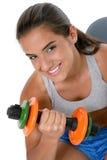 Menina adolescente bonita na roupa do exercício com pesos foto de stock royalty free