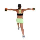 Menina adolescente bonita na roupa do exercício que demonstra o Lunge Imagem de Stock