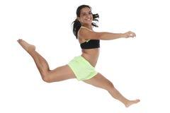 Menina adolescente bonita que salta no ar Fotos de Stock Royalty Free