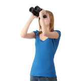 Menina adolescente com binocular Imagens de Stock