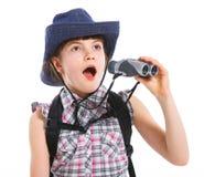 Menina adolescente com binocular Fotos de Stock