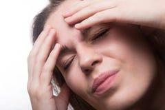 Menina adolescente com dor de cabeça Imagens de Stock Royalty Free