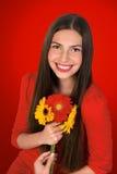 Menina adolescente com flores imagem de stock