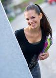 Menina adolescente com livros Imagens de Stock