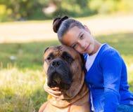 Menina adolescente com o cão Imagens de Stock