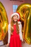 Menina adolescente com os balões do ano novo Fotos de Stock Royalty Free